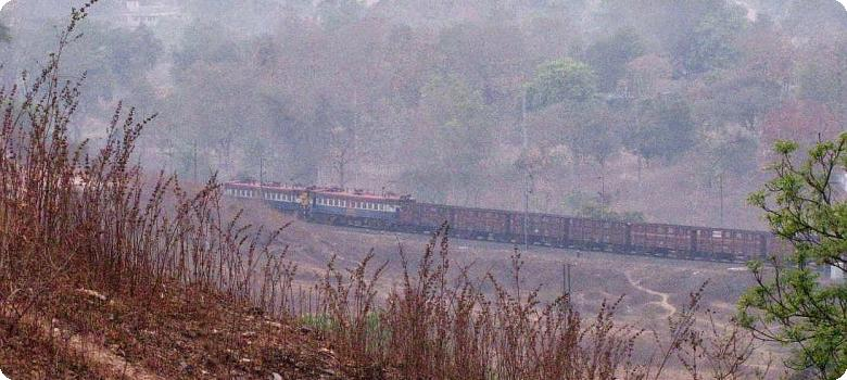 Train vanishing round the bend at Manoharpur