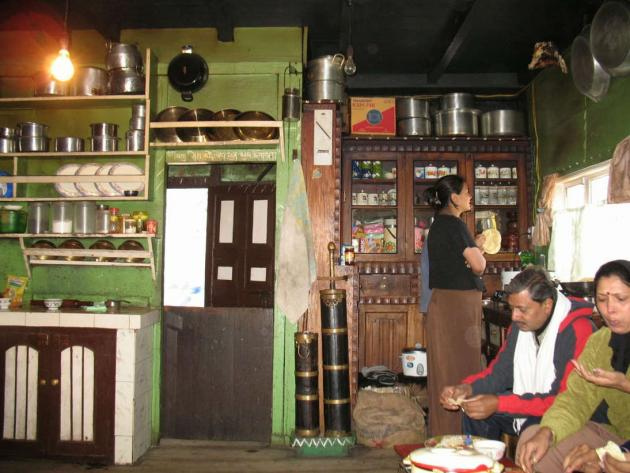 Guests eating at a Lepcha family kitchen
